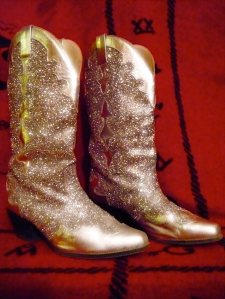 Hmmm, sparkly cowboy boots? Two birds, one diamond-like stone.