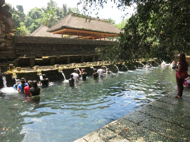 Taking a bath at a temple.