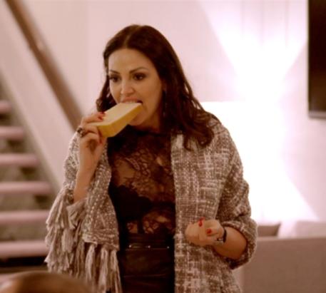 Bleona eating cheese.