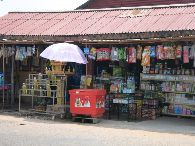 You can see the gasoline in the soda bottles just to the left there at this more established roadside stall.